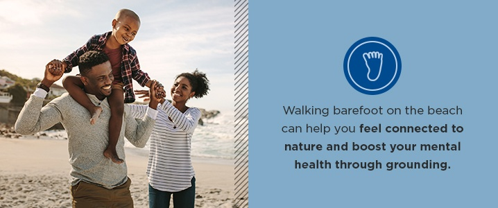 Walking barefoot on the beach can help you feel connected to nature and boost your mental health through grounding